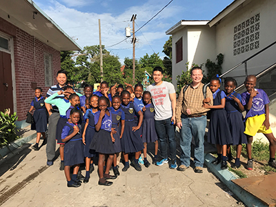 Sam Lollar with Jamaican Catholic school children