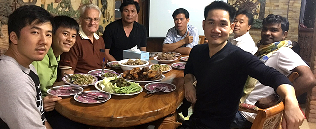 Bro. Binh Nguyen SVD, having dinner with his local community