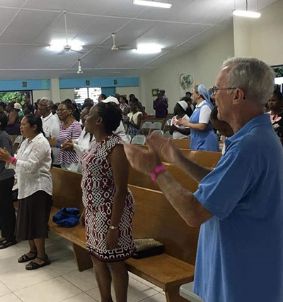 Fr. Frank Power, SVD, participates in Mass at a caribbean church