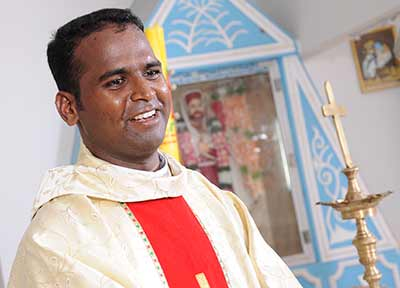 Fr. Francis Rayappan, SVD, smiles during his first Mass in India