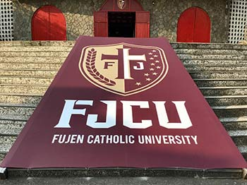 Fu Jen University banner unrolled on steps to a building