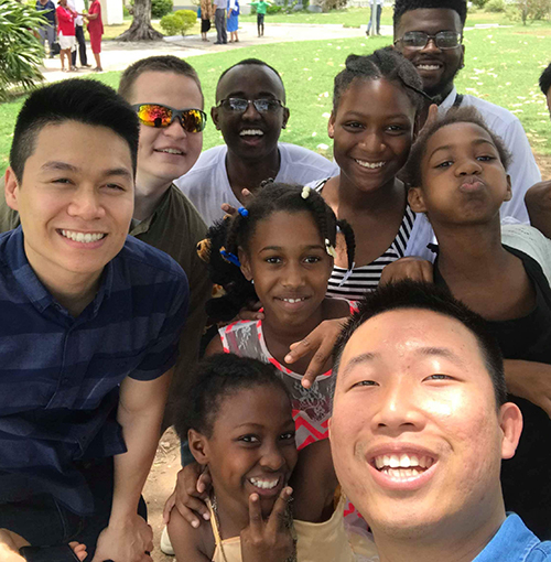 Mission Jamaica participants take a selfie with Jamaican children